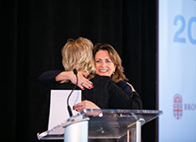 A hug during the Volunteer Summit